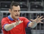 Serbia coach Zoran Terzic reacts to a missed point against China during a women's volleyball preliminary match at the 2012 Summer Olympics, at Earls Court Saturday, July 28, 2012, in London. (AP Photo/Chris O'Meara)