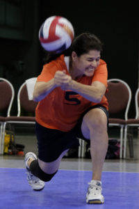 Nan Hieb of the Dayton Diggers bumps the ball agents the Ice Pack of TX during the 50-54-year-old volleyball competition at the National Senior Games held in the Minneapolis Convention Center, MN on July 11, 2015. The Dayton Diggers would go on to win. (Photo by ©Barclay Fernandez 2015)